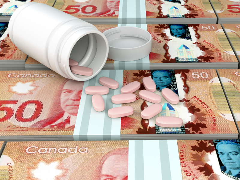 Des pilules sur des billets de 50$ canadiens